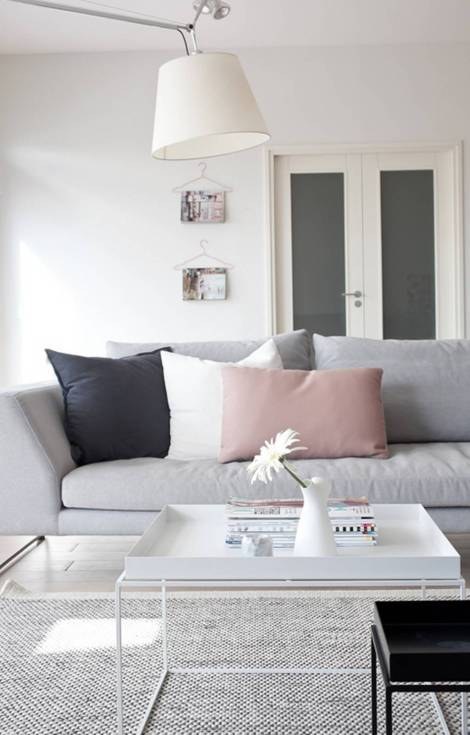 Modern neutral interior with blush pillow