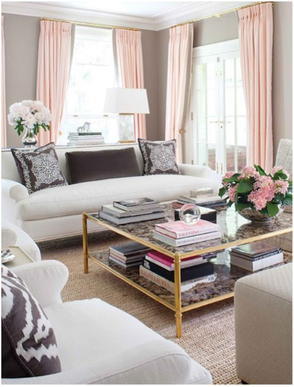 Blush and grey living room with gold accents and girly pillows