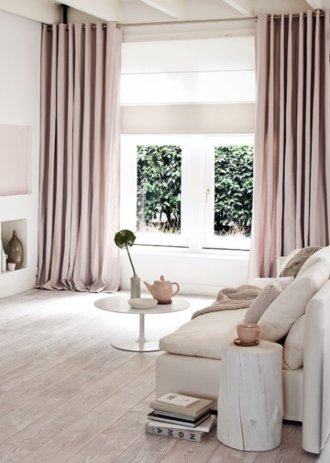 Neutral living room with blush pink draperies