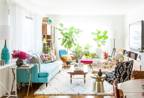 Emily Henderson interior design for Bri Emery. Teal sofa in a white & bright room with more teal accents.